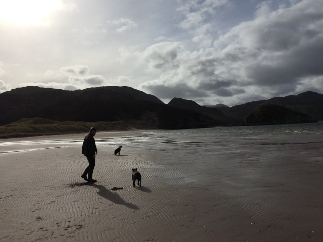 Charles Parkes about to start running with our two dogs on a scottish beach