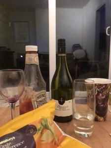 Wine-bottle-ketchup-crisp-packet-dark-Charles-Parkes-writer